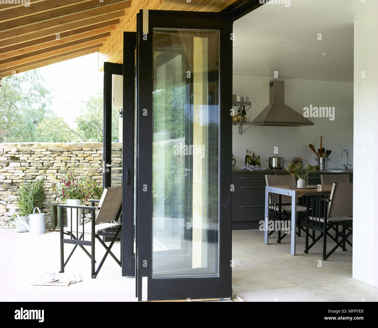 Covered Private Patio With Open French Doors To A Tiled Eat In