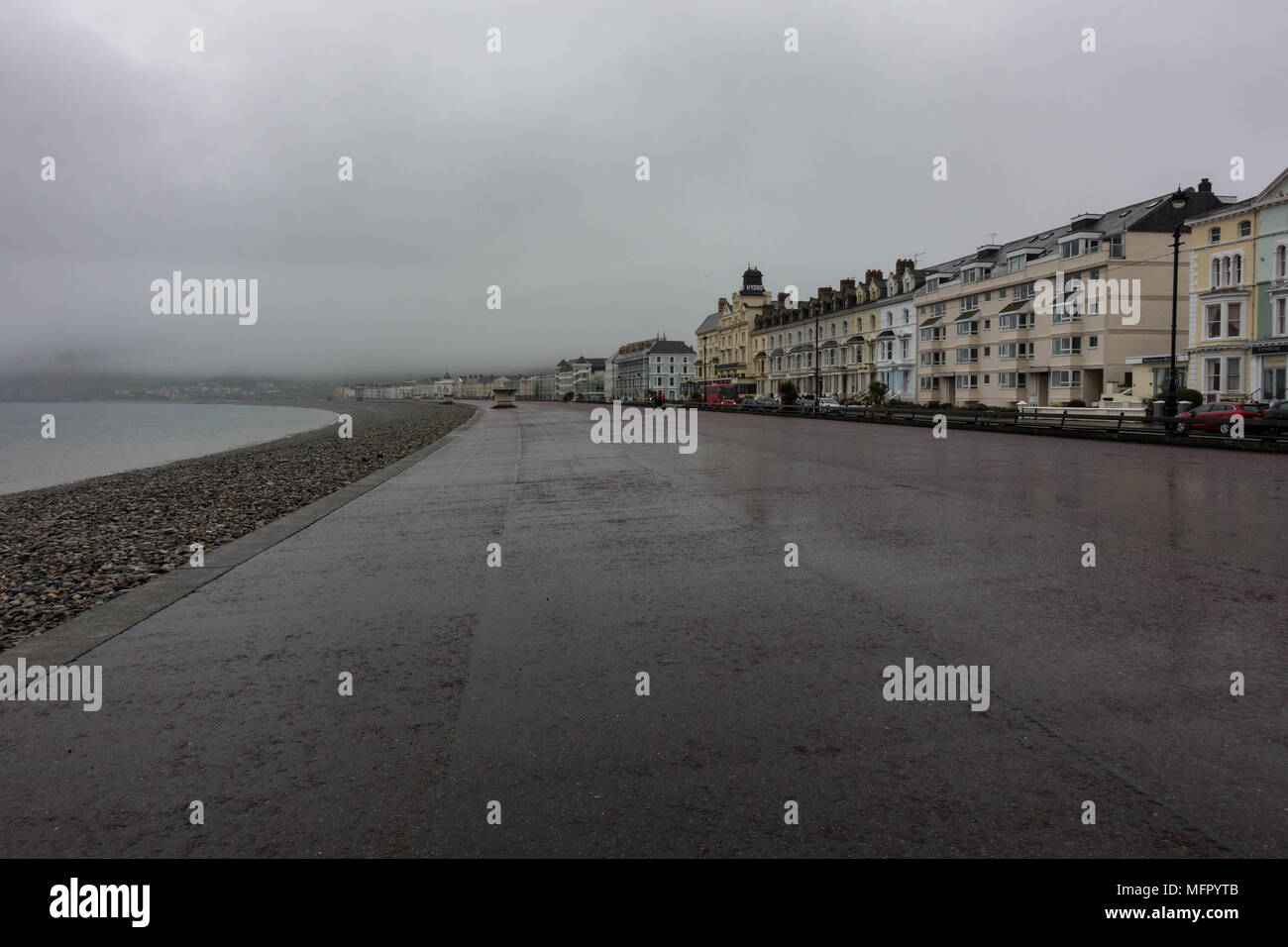 Lllandudno Promenade in the rain. April 2018. Wales - Stock Image
