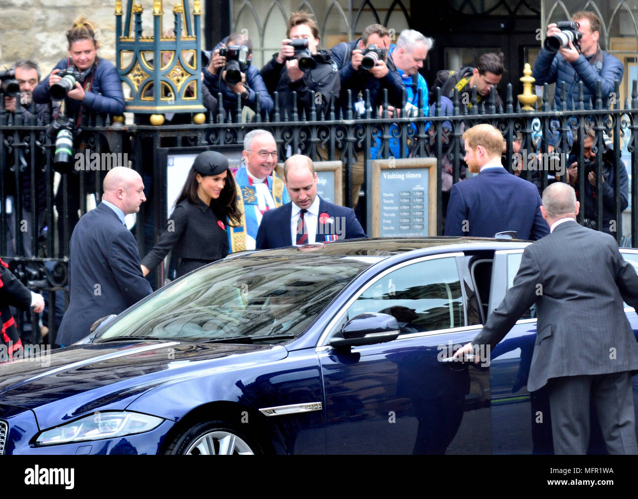 Anzac Day 2018 Service of Commemoration at Westminster Abbey. Prince William, Prince Harry and Meghan Markle leave after the service with Very Rev Joh Stock Photo
