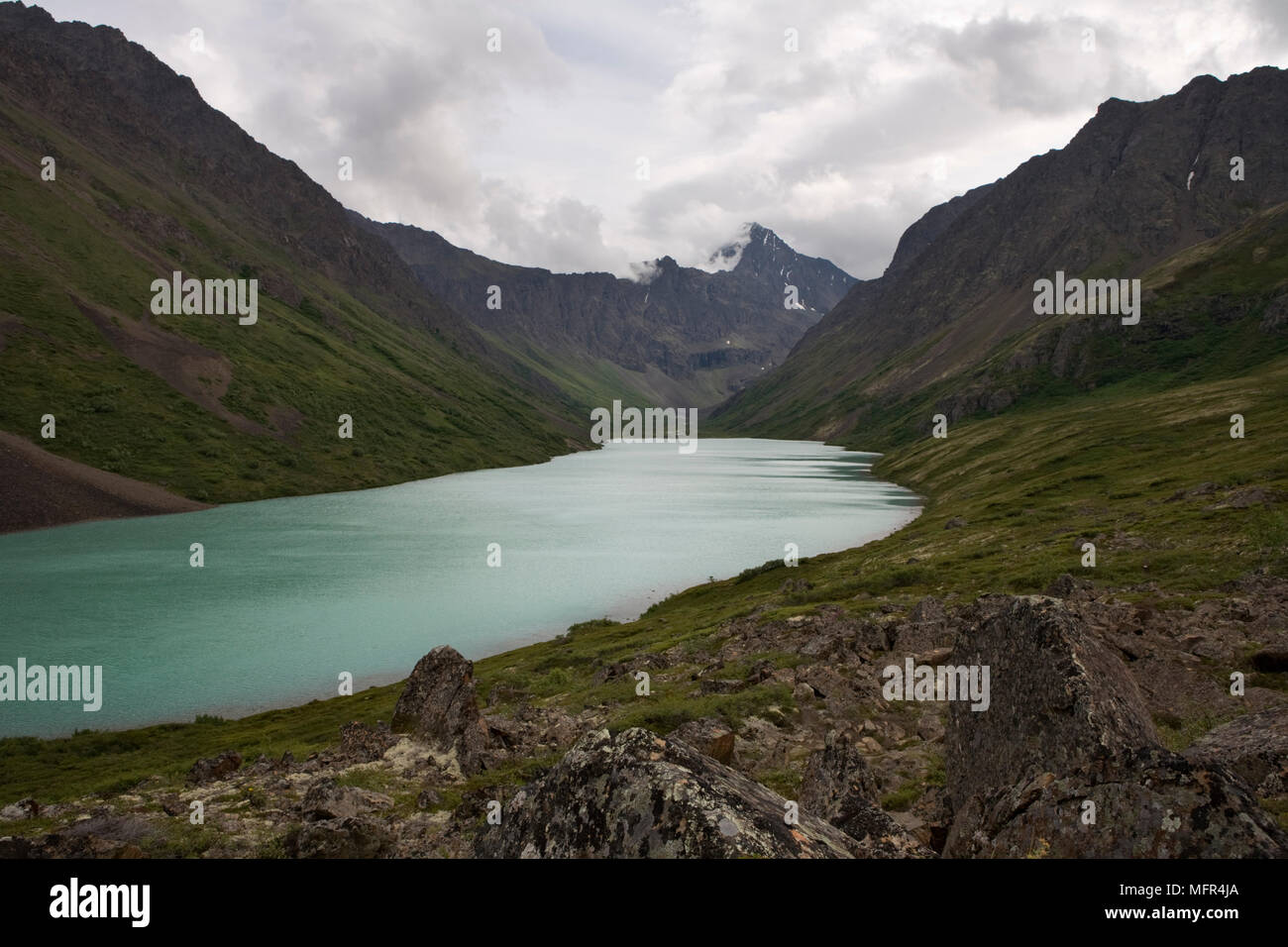 Eagle Lake in the Chugach State Park, Alaska, can be reached on a wonderful day hike. Nearby Symphony Lake can be reached after crossing a large bould - Stock Image