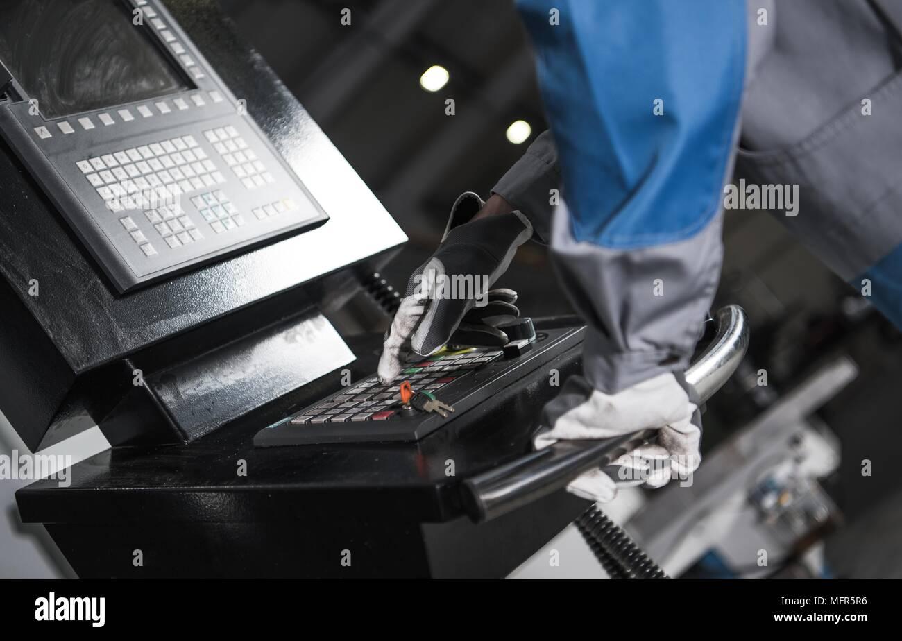 CNC Machine Control Panel Operator Closeup Photo. Metalworking and Manufacturing Concept Photo. Stock Photo