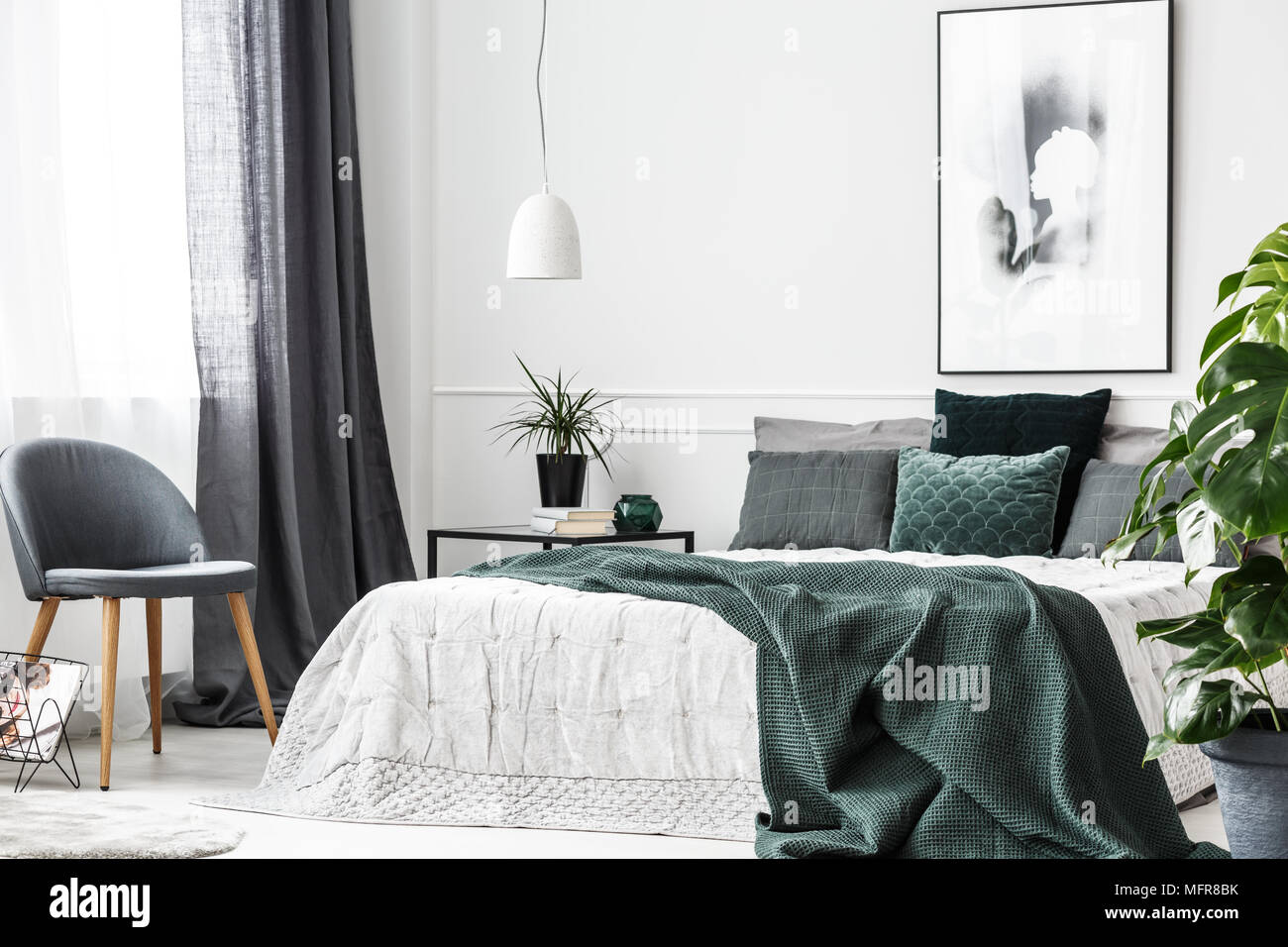 Emerald Green Blanket And Pillows On White Bed In Cozy Bedroom Interior With Gray Chair And Poster Stock Photo Alamy