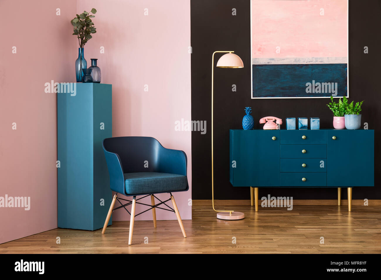 Blue and pink living room interior with an armchair, cabinet ...