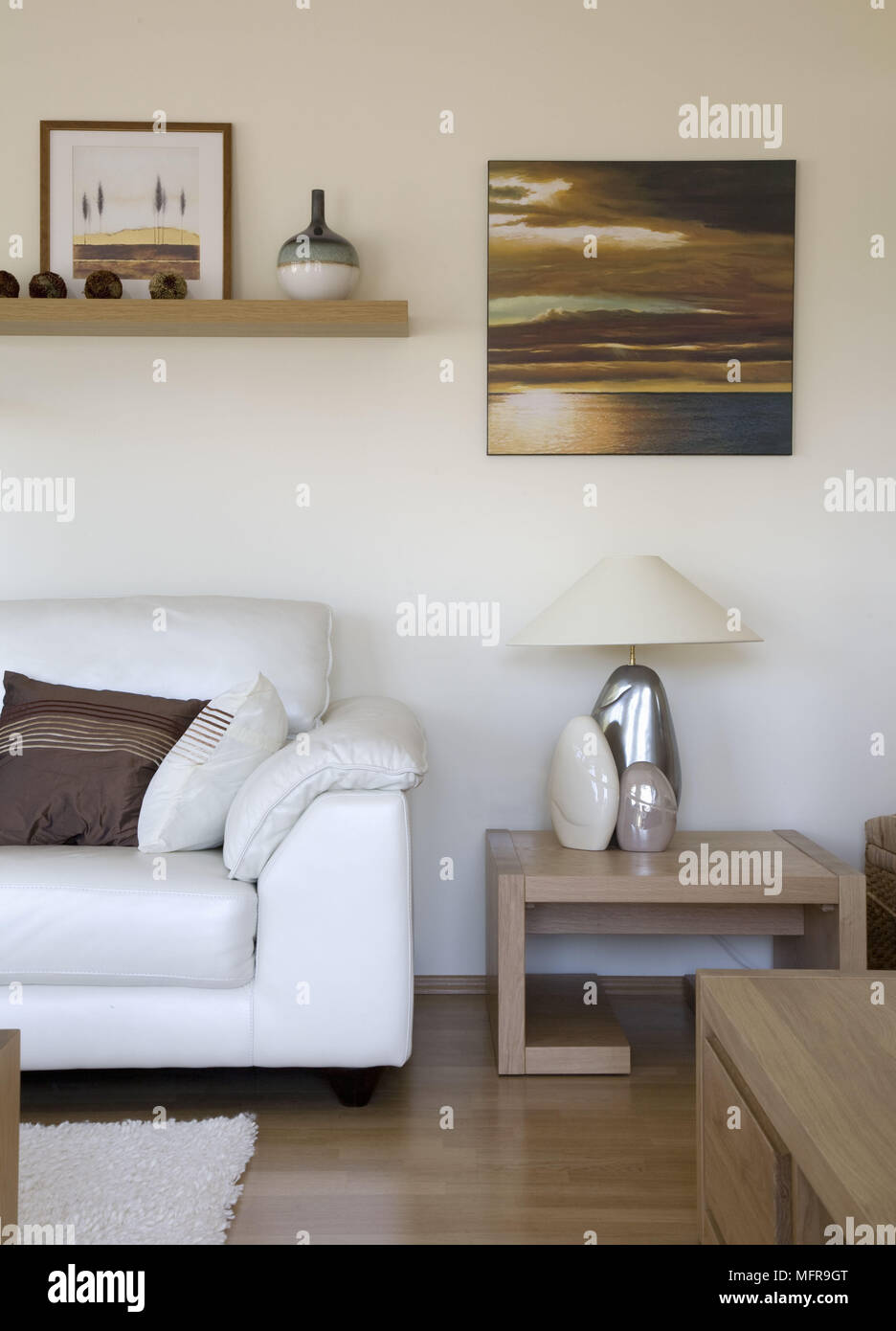 Ceramic Lamp On Wooden Side Table Next To White Sofa In