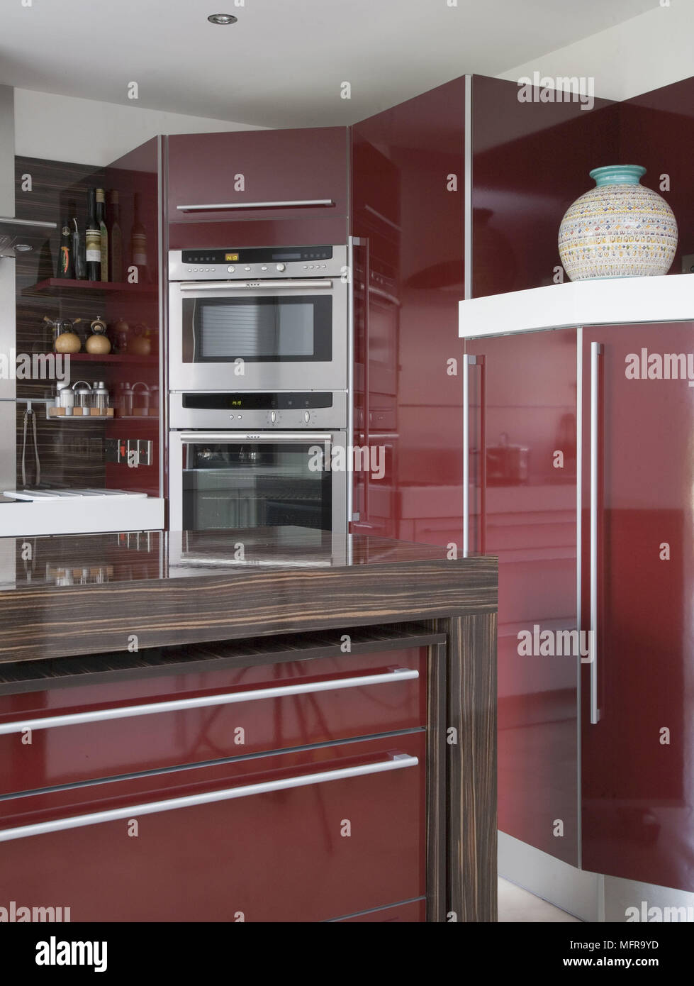 Modern Kitchen With Integral Oven Set In Red Units Stock Photo