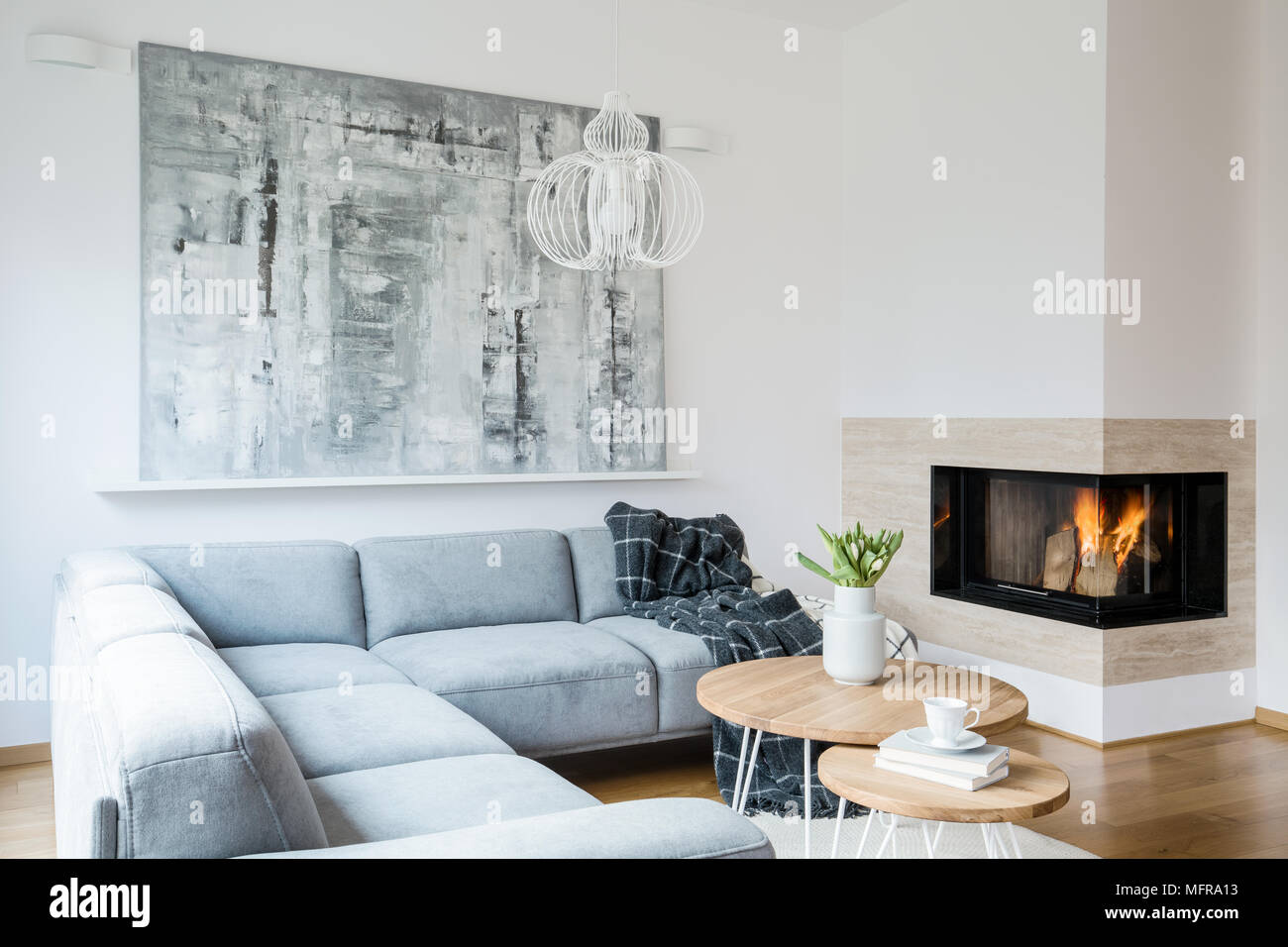 99 Beautiful White And Grey Living Room Interior: Black Blanket Thrown On A Grey Corner Lounge In White