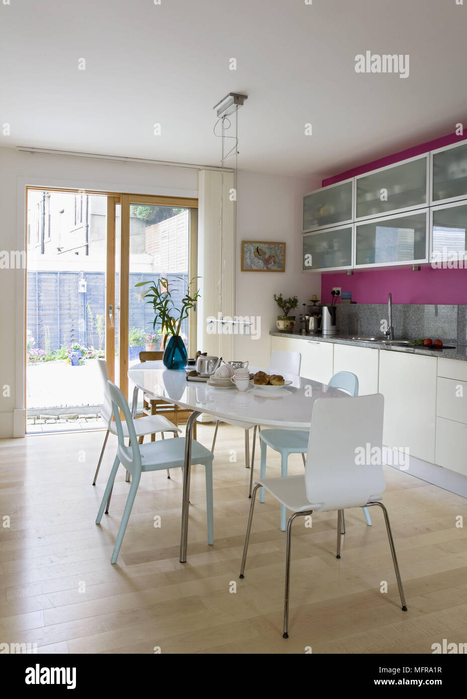 Oval dining table and chairs in centre of contemporary ...