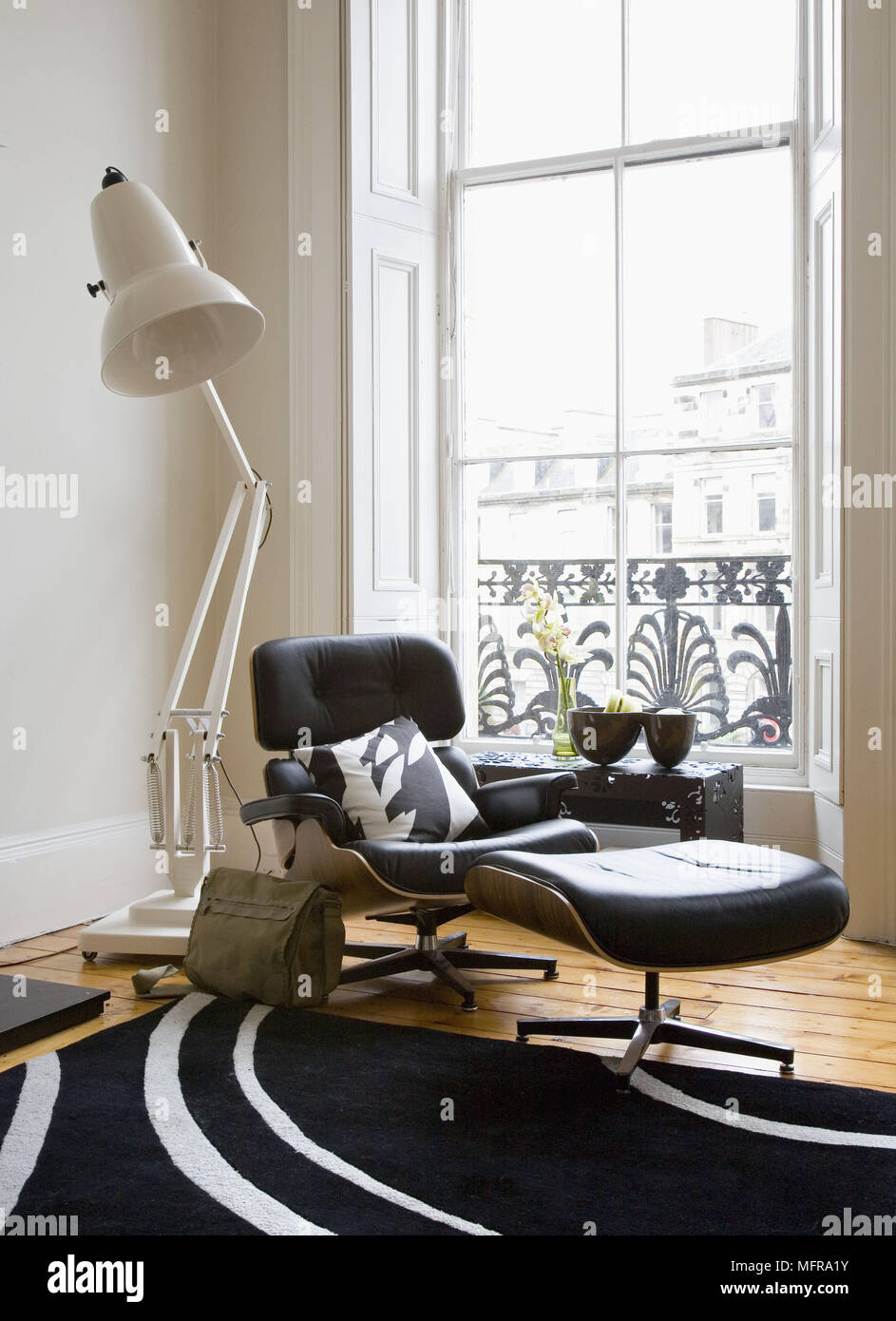 Oversize Anglepoise Floor Lamp Behind Eames Lounge Chair And Ottoman In  Front Of Window