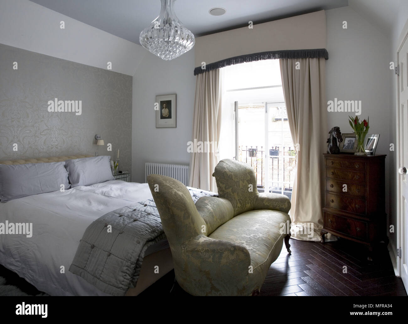 Period Style Sofa At Foot Of Double Bed In Traditional Style Bedroom Stock Photo Alamy