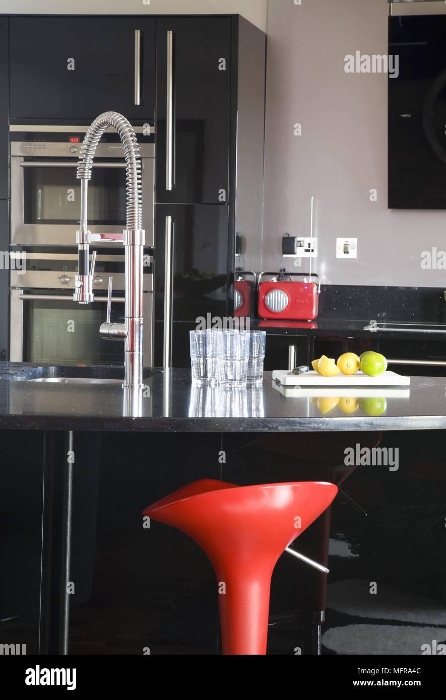 Sensational Red Bar Stool At Breakfast Bar In Contemporary Kitchen Stock Machost Co Dining Chair Design Ideas Machostcouk