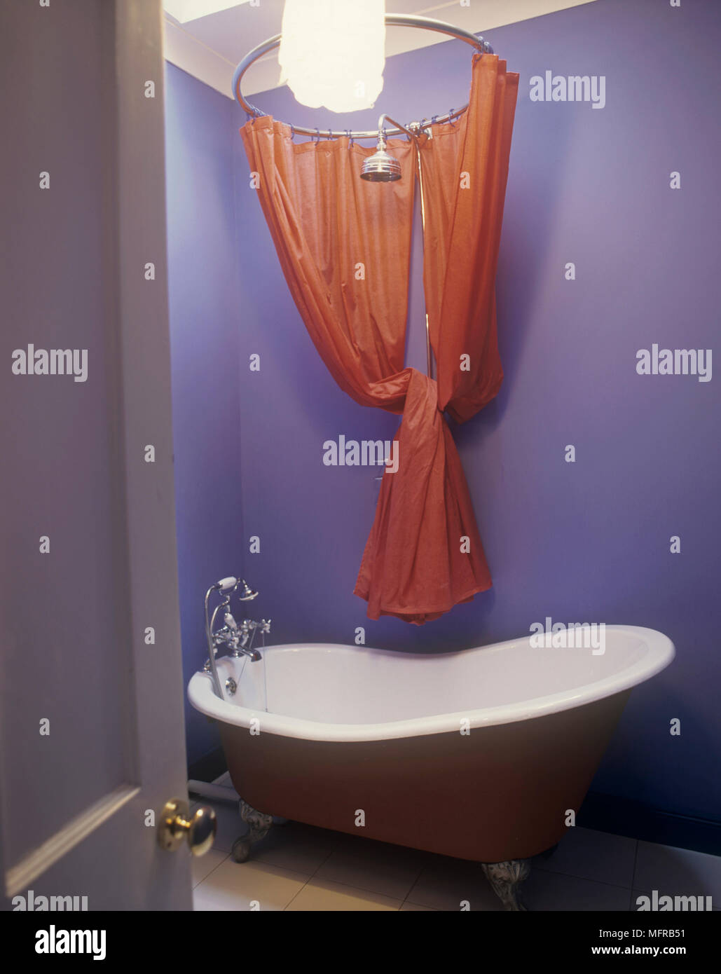 Blue Painted Bathroom With Claw Footed Bathtub Red Shower Curtain And Steel Fittings Above