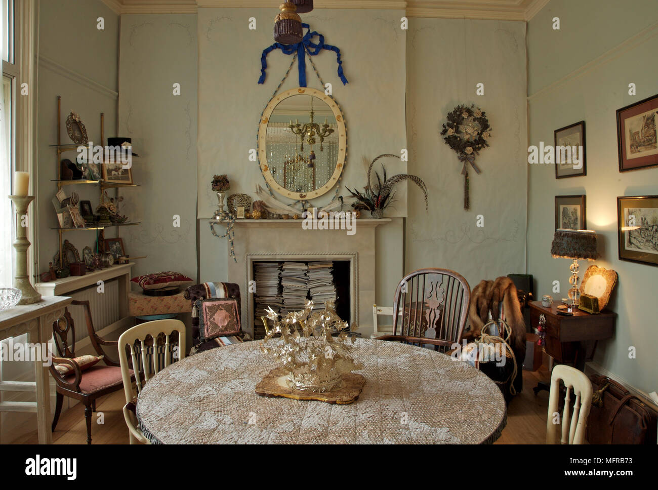 Bohemian dining room with circular table and fireplace Stock ...