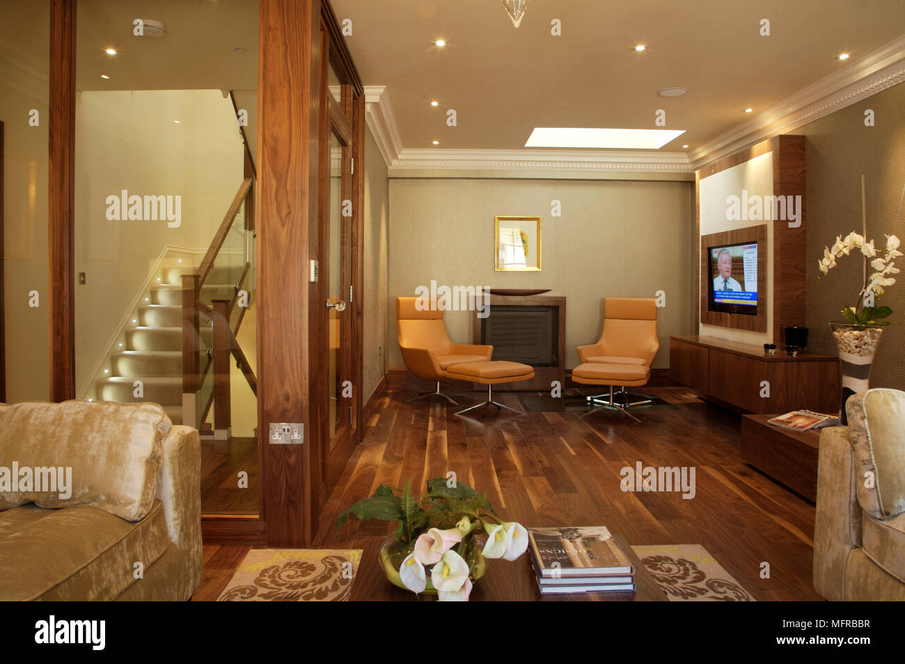Sitting Room With Wood Floor And Lounge Chairs In Front Of