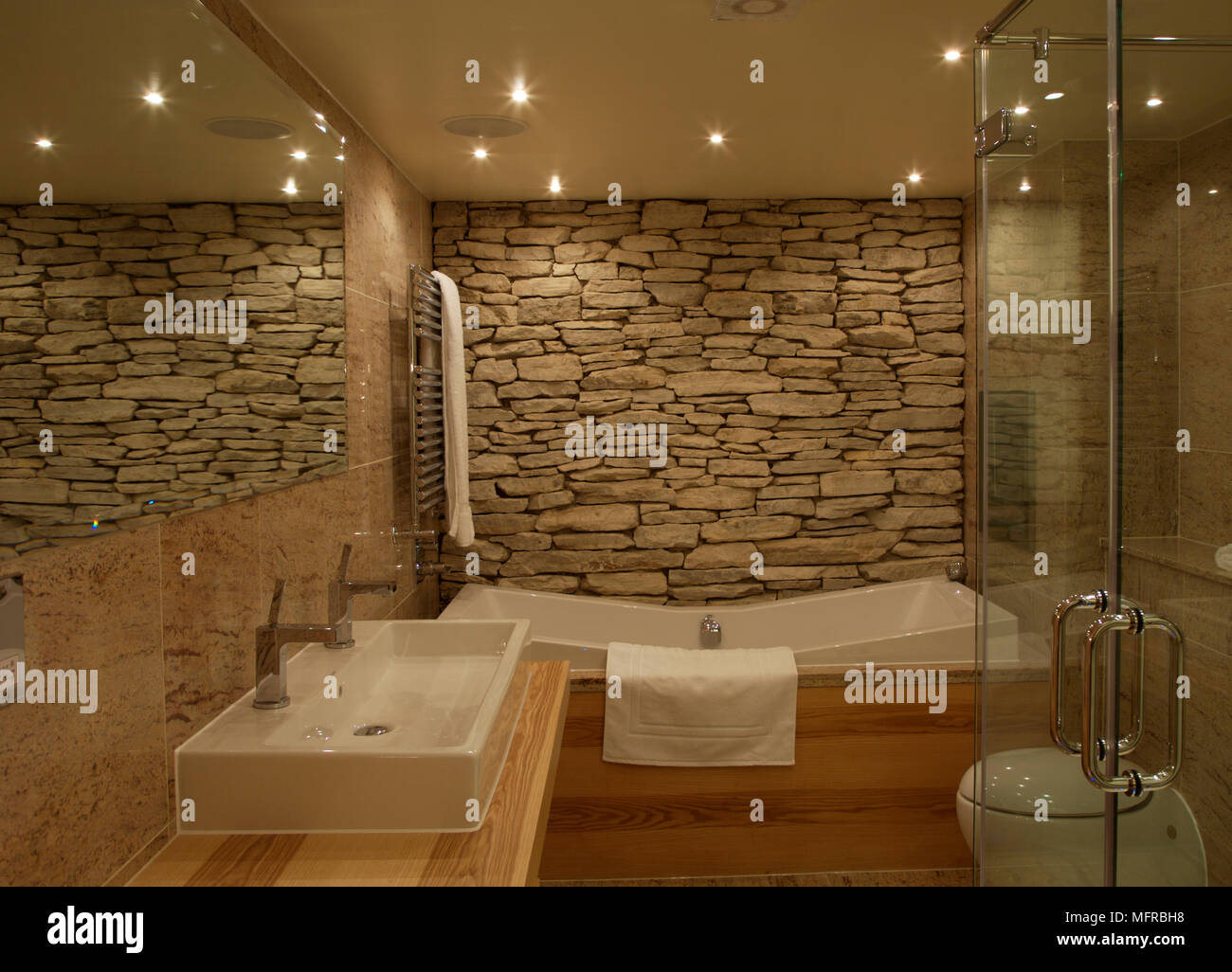 Exceptionnel Ensuite Bathroom With Exposed Stone Wall And Bare Wood Units ...
