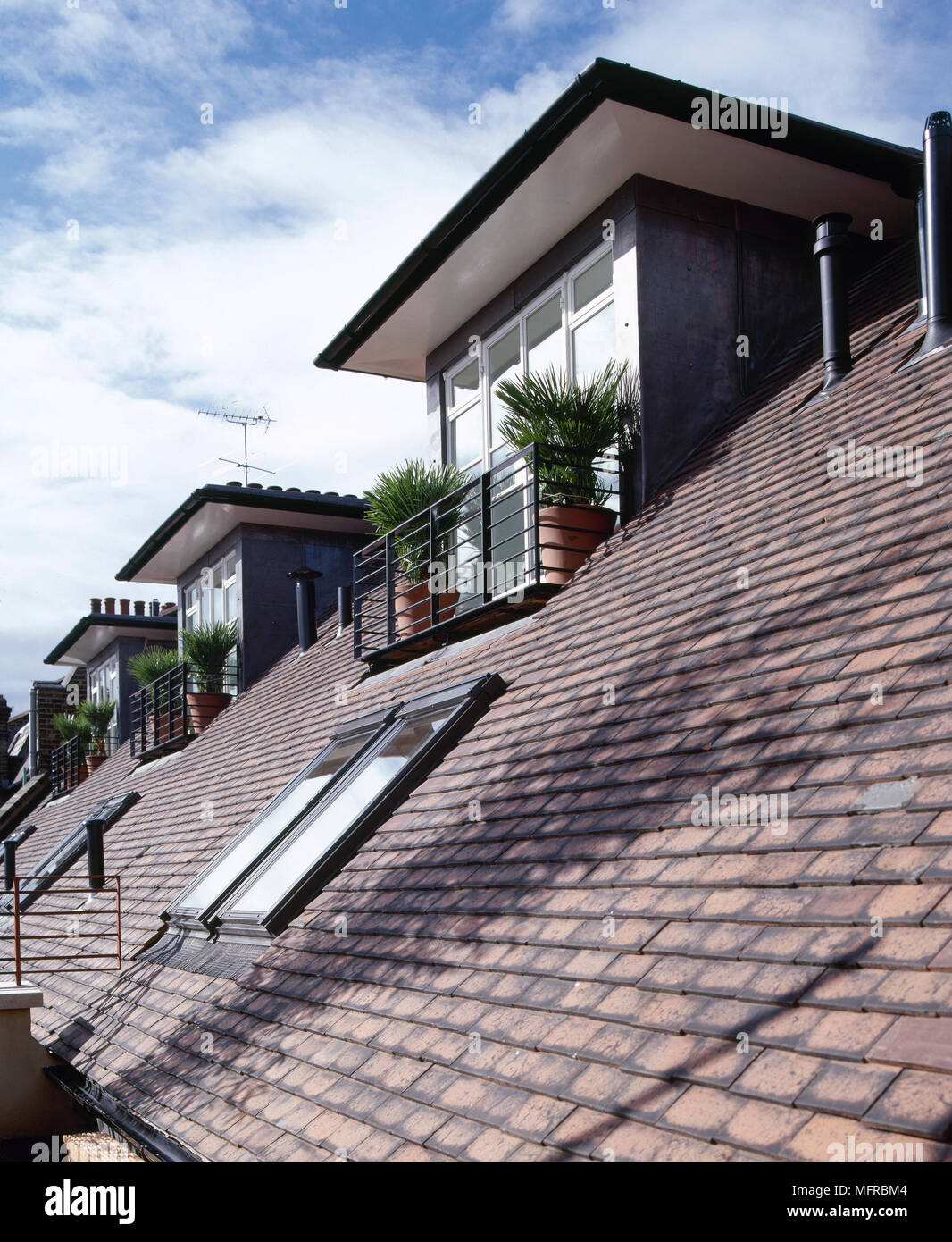 Detail Of Tiled Roof Of Modern House With Dormer Windows