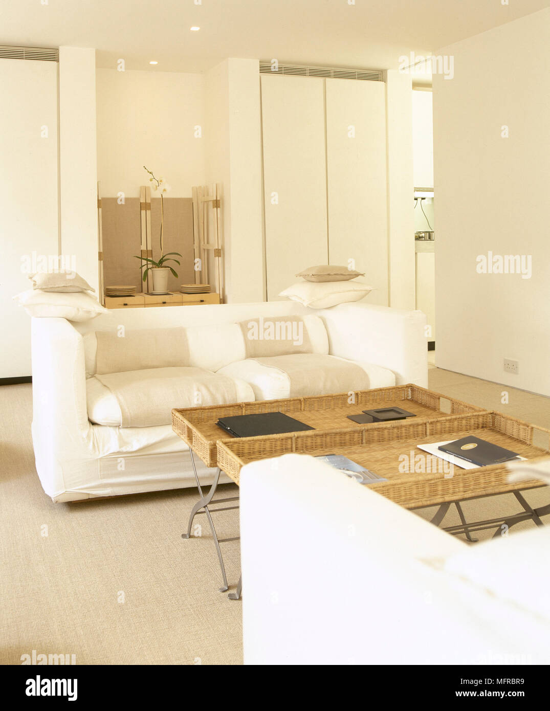 Bright, modern sitting room with overstuffed sofas, built-in ...
