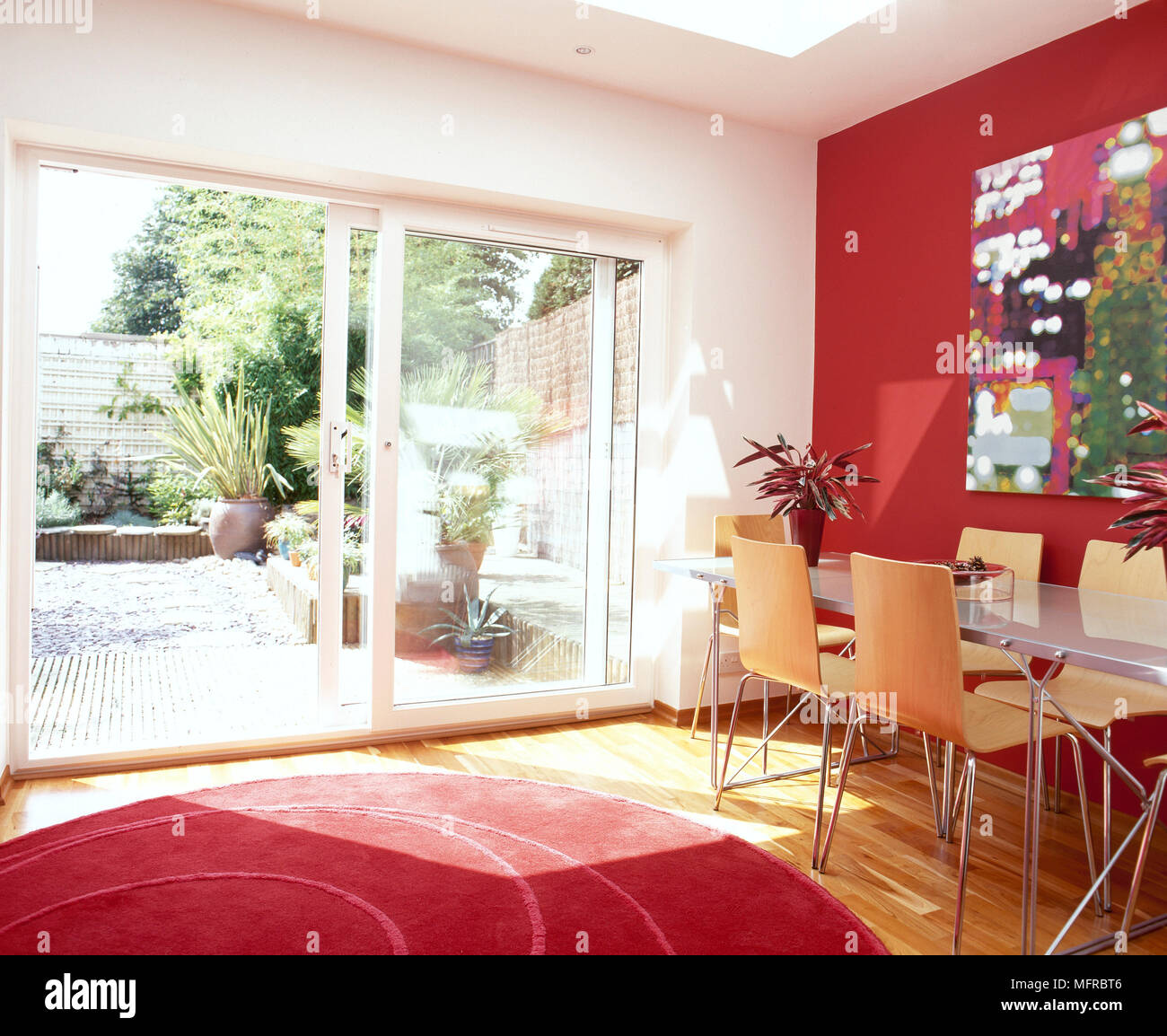 Dining Room With Red Accent Wall And Rug Dining Table And Chairs