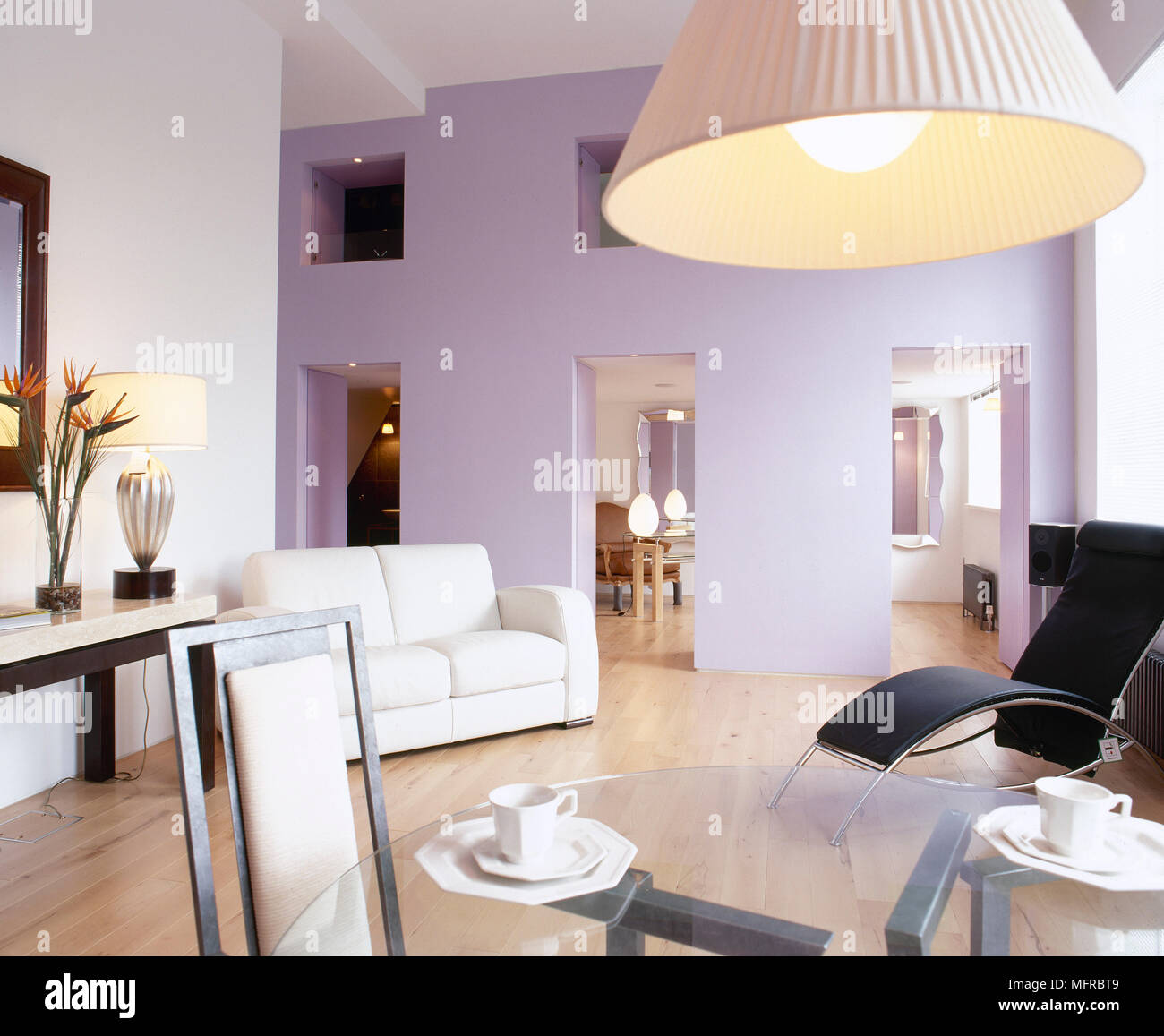 Swell Glass Top Dining Table Sofa Wood Floor And A Lilac Accent Download Free Architecture Designs Photstoregrimeyleaguecom