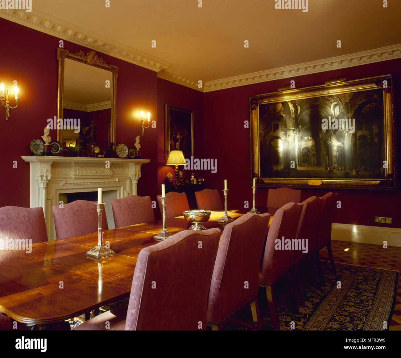 Red dining room with wooden dining table, upholstered chairs ...