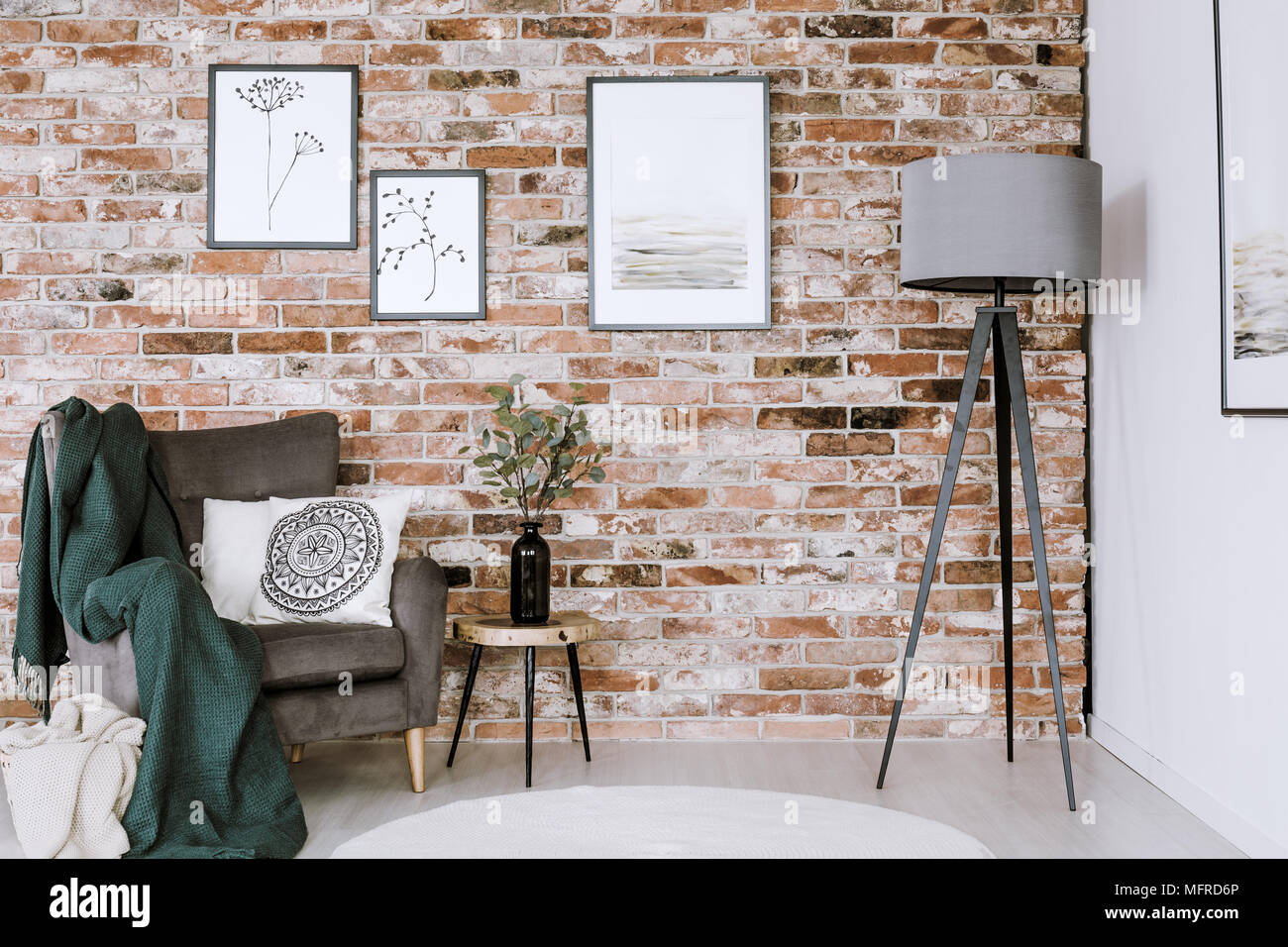 Grey Lamp And Armchair With White Pillow Set On A Brick Wall Posters In Living Room Interior