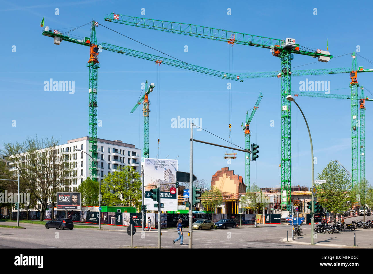 New luxury high-rise  apartment building (Upside) under construction beside East Side Gallery in Friedrichshain, Berlin, Germany. Property development Stock Photo