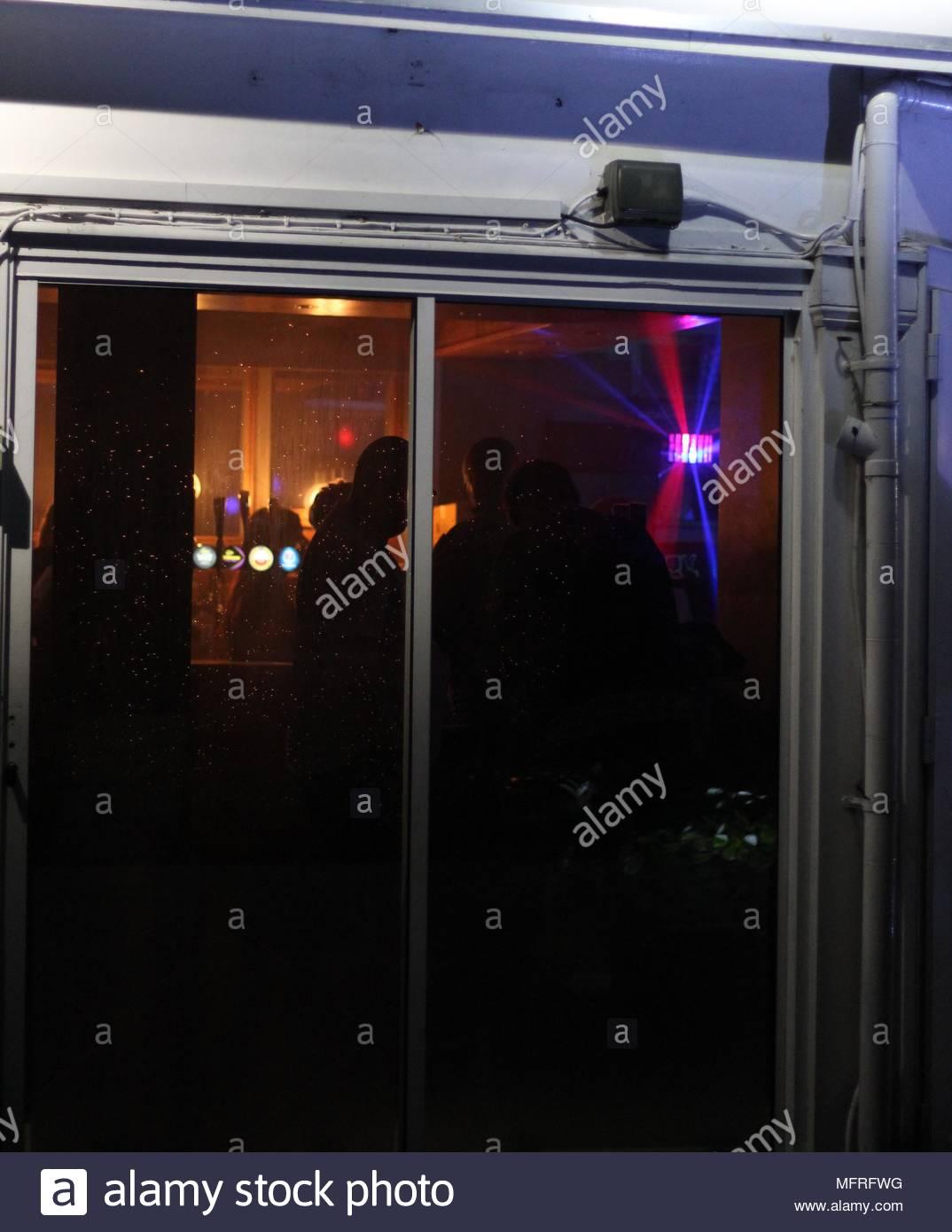 View through a nightclub window at night, Britain, UK. - Stock Image