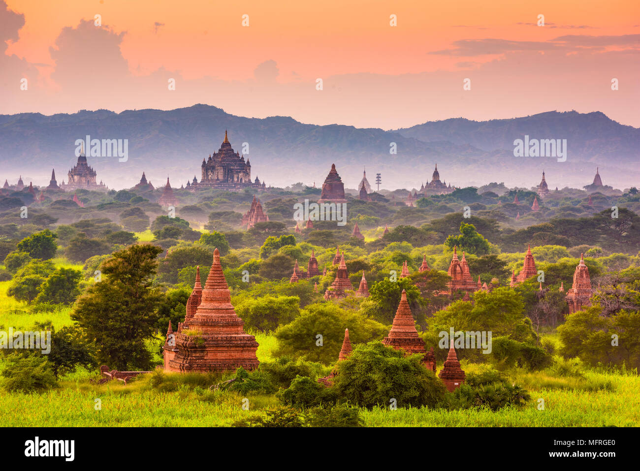 Bagan, Myanmar ancient temple ruins landscape in the archaeological zone at dusk. Stock Photo