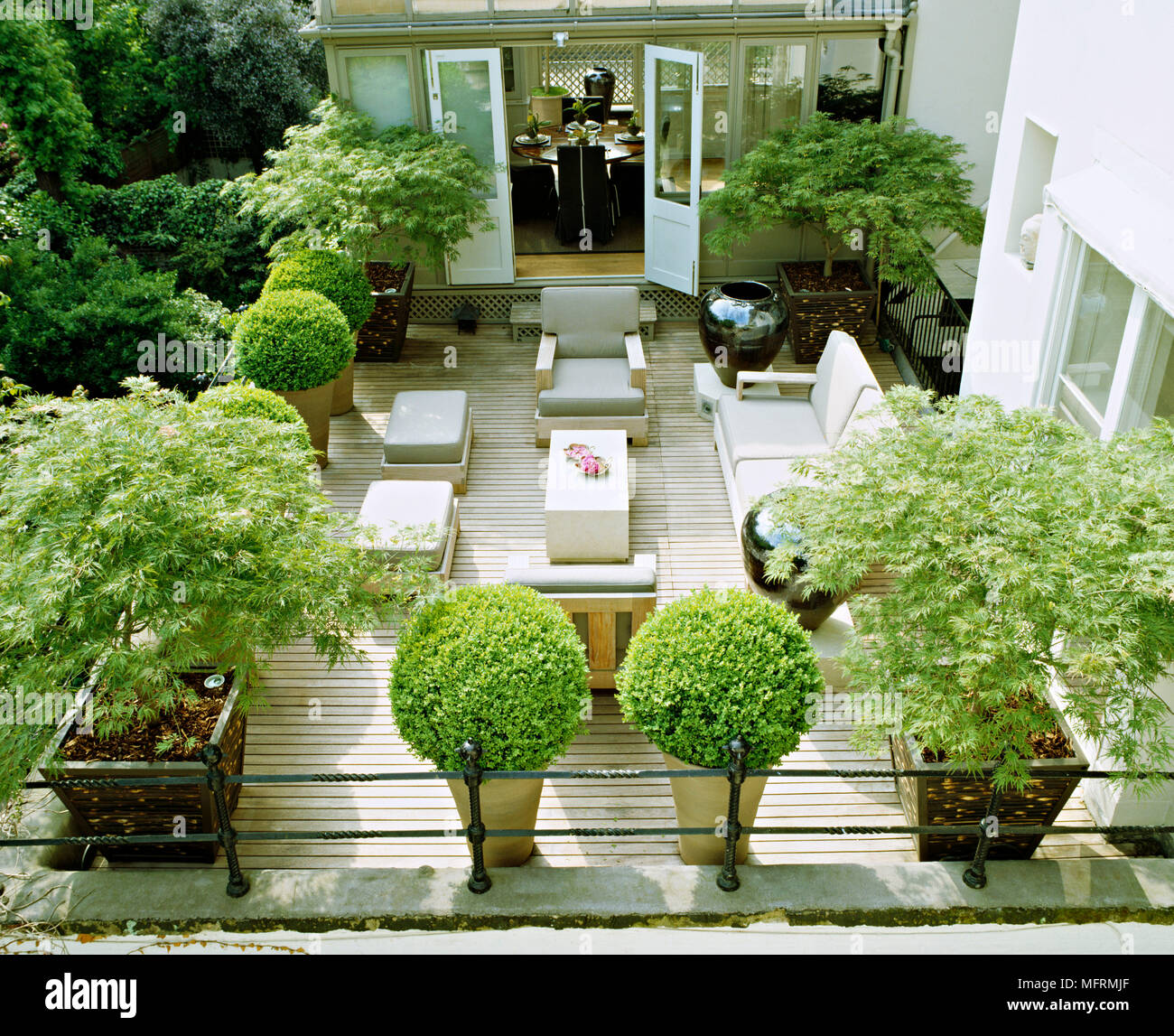 A Modern Town Garden Roof Terrace With Decked Patio Area Table And