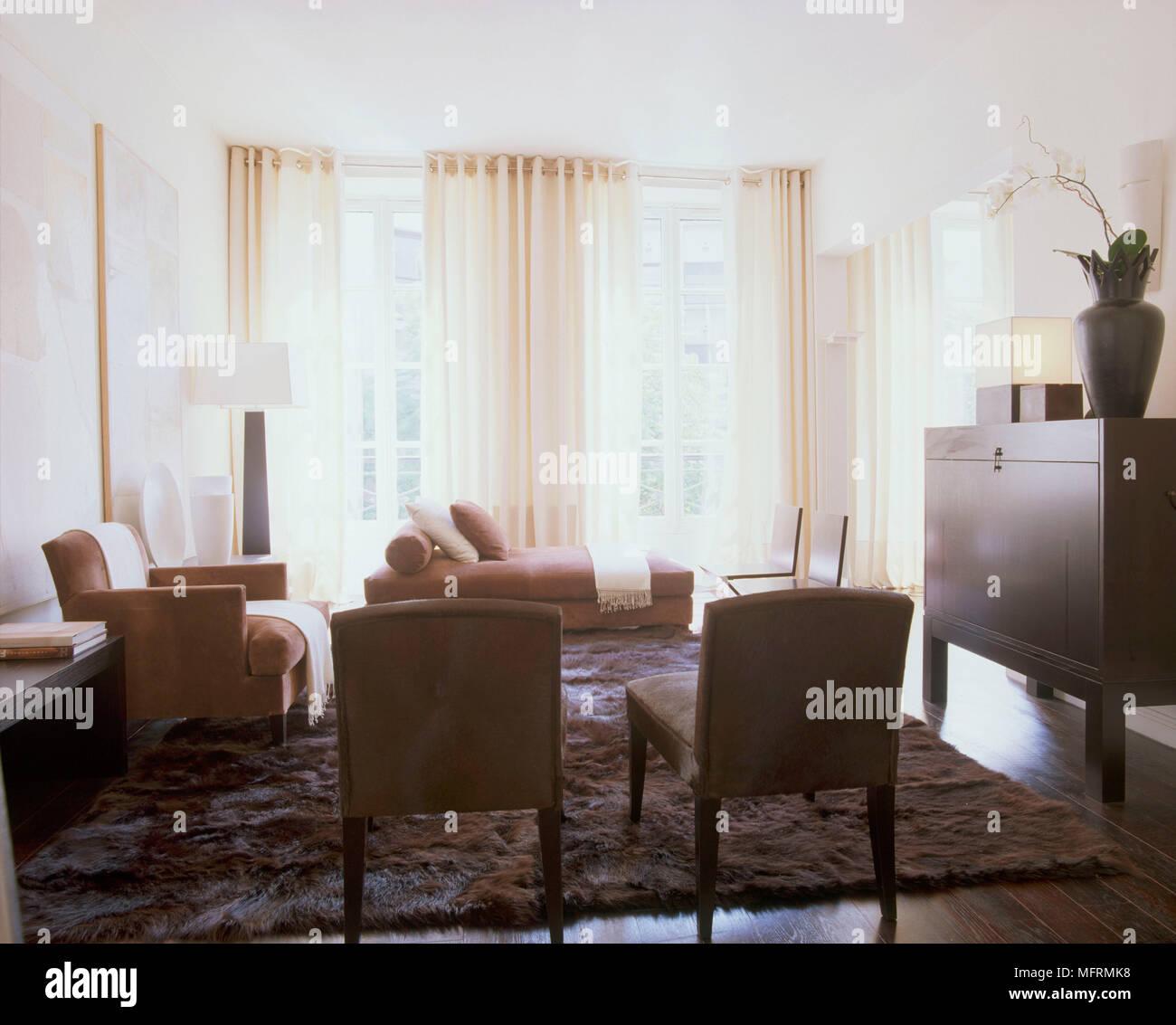 A modern sitting room wood cabinet wood floor rug upholstered ...