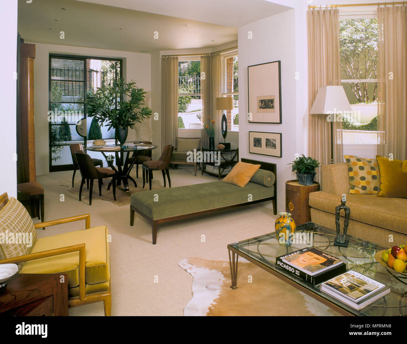A Modern Open Plan Sitting Room With Dining Area Upholstered