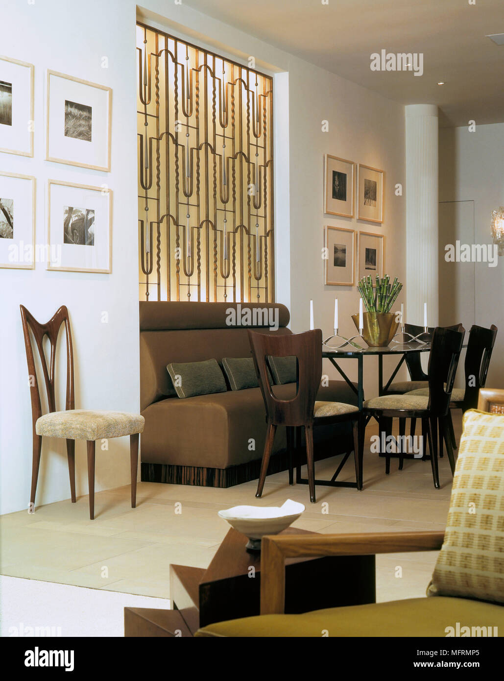 A Modern Open Plan Dining Room With Glass Table Chairs Banquette