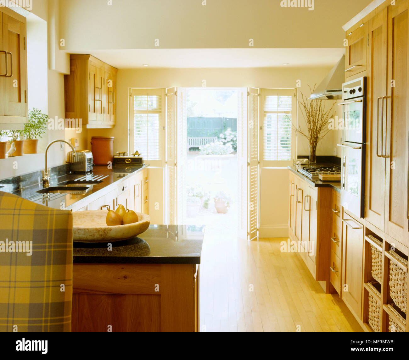 A Modern Country Style Kitchen With Dining Area Wood Units Integral