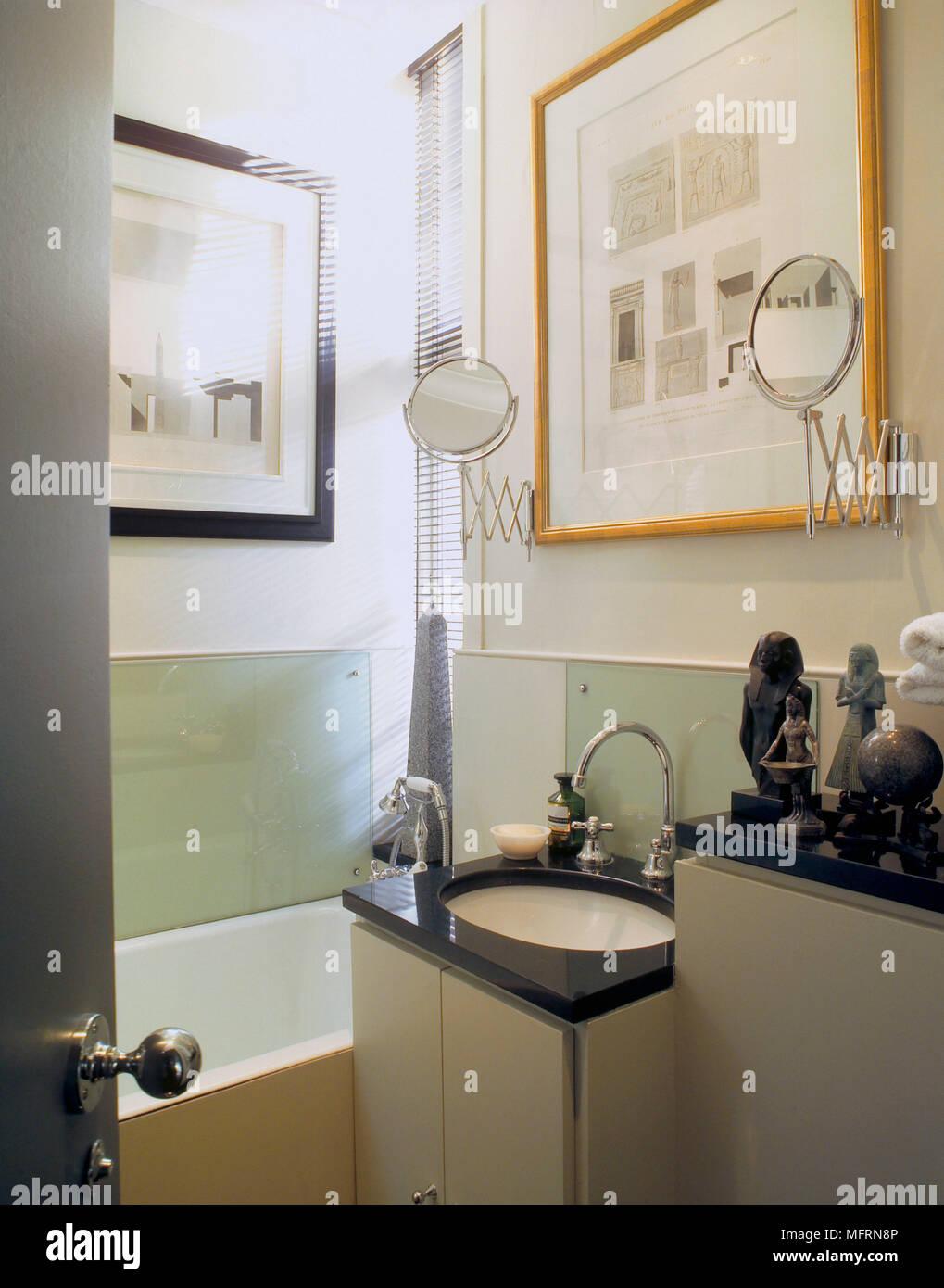 A Detail Of Modern Bathroom Wash Basin Set In Cupboard Unit Perspex Splashback Extending Mirror