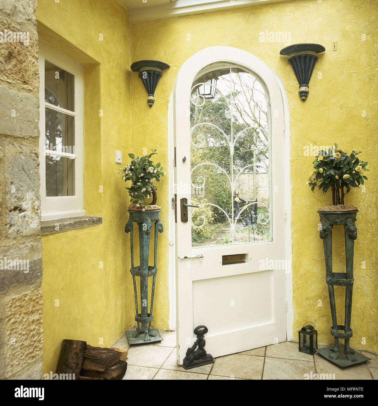 Country Style Yellow Hallway With Front Door Open Stock Photo