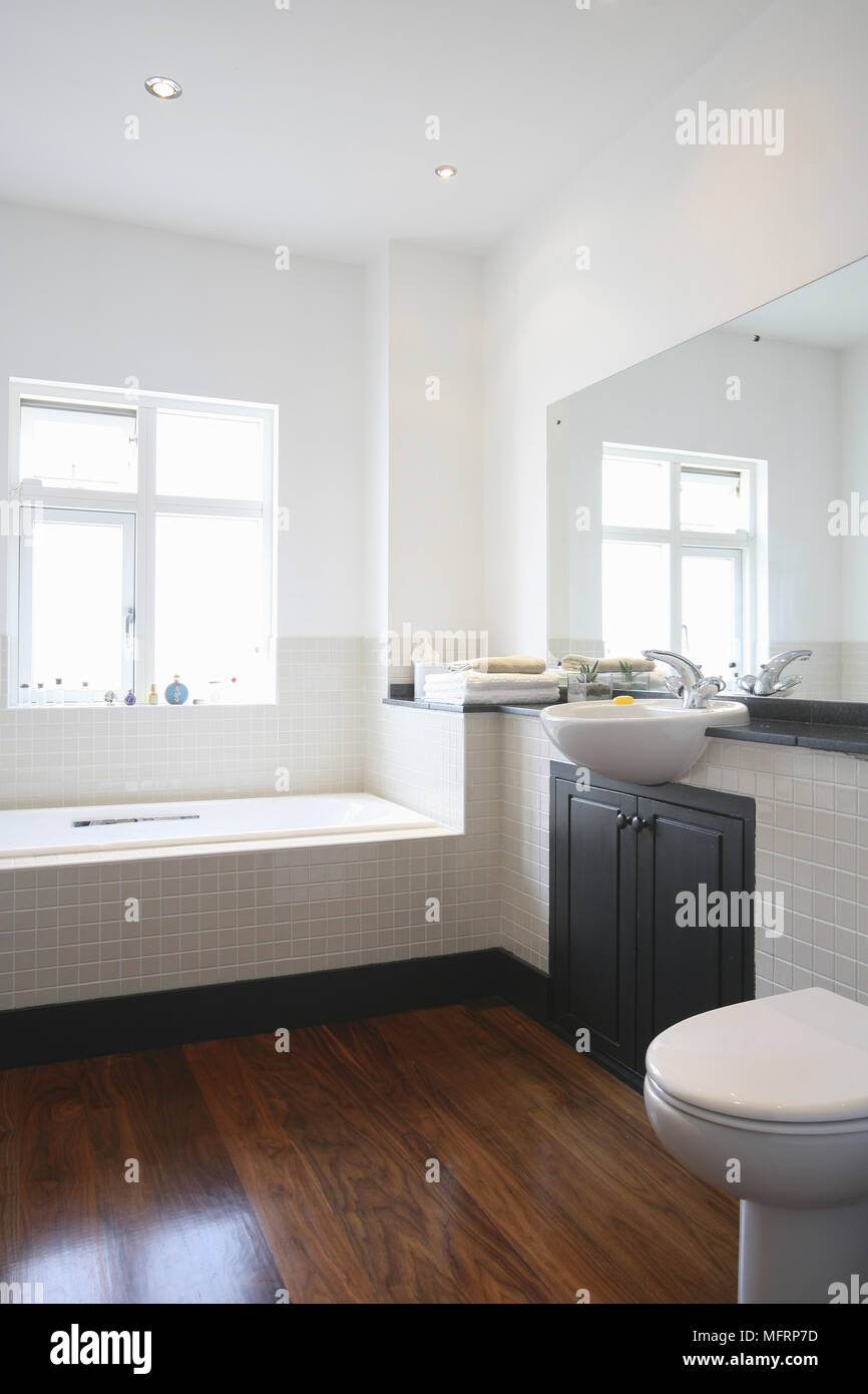 Washbasin Set Over Cupboard Unit Next To Tiled Bathtub