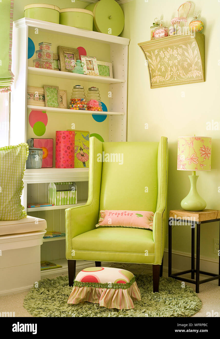 Upholstered Lime Green Chair In Corner Of Bedroom Stock