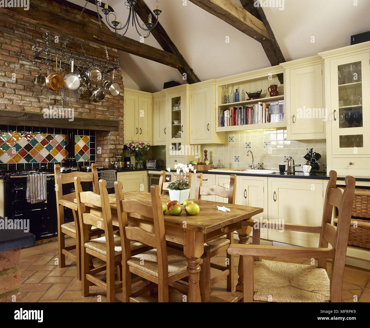 Country style kitchen with pine dining table and chairs ...