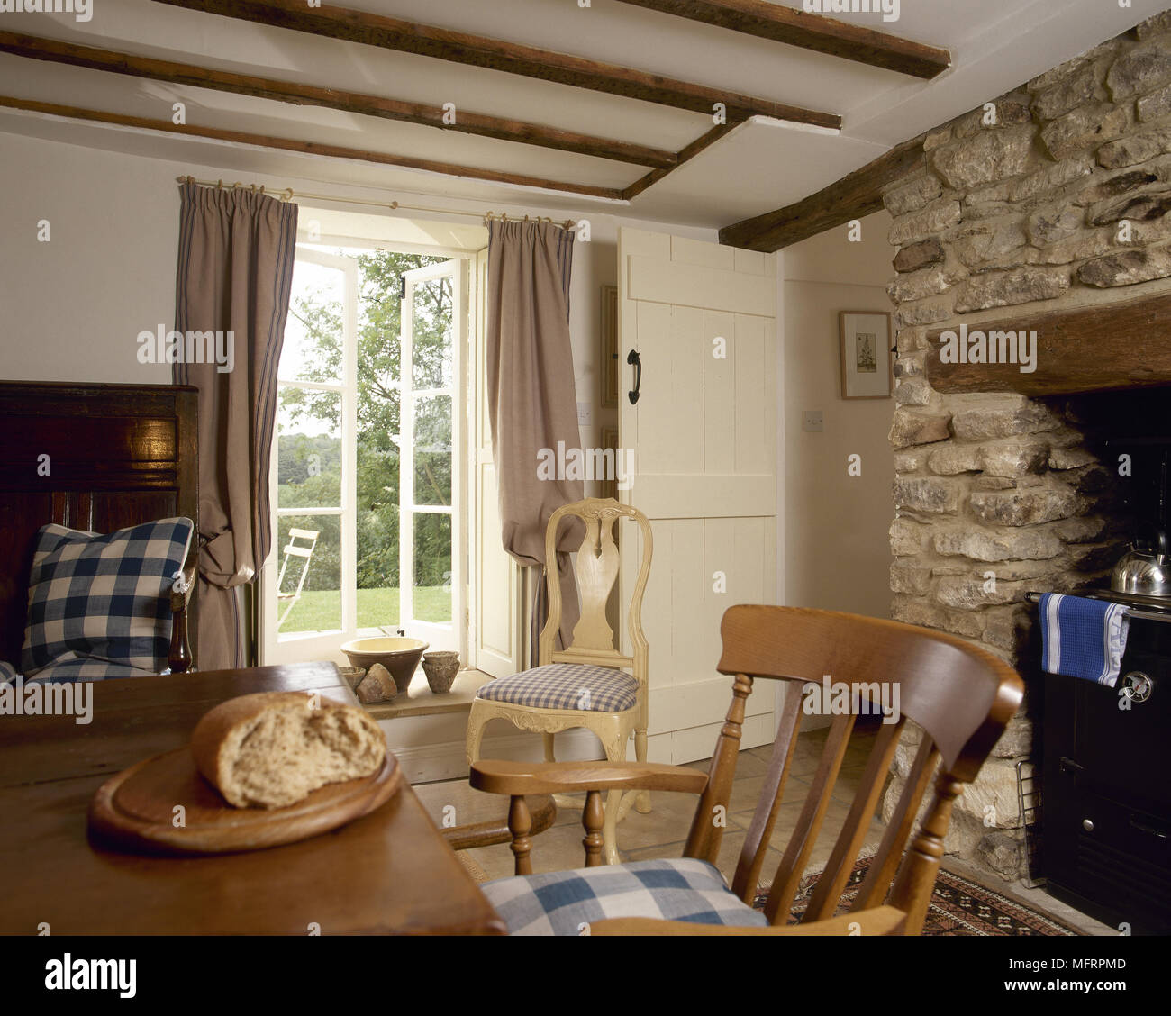 Country Cottage Dining Area With Wood Beamed Ceiling And A ...
