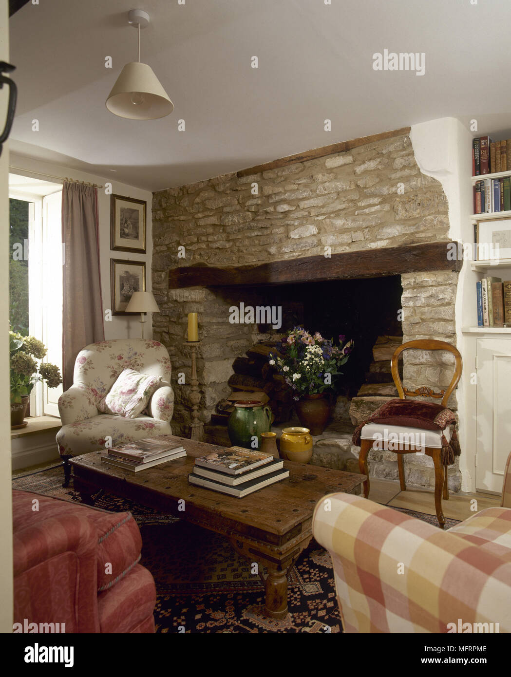 Country Cottage Sitting Room With A Wooden Coffee Table And