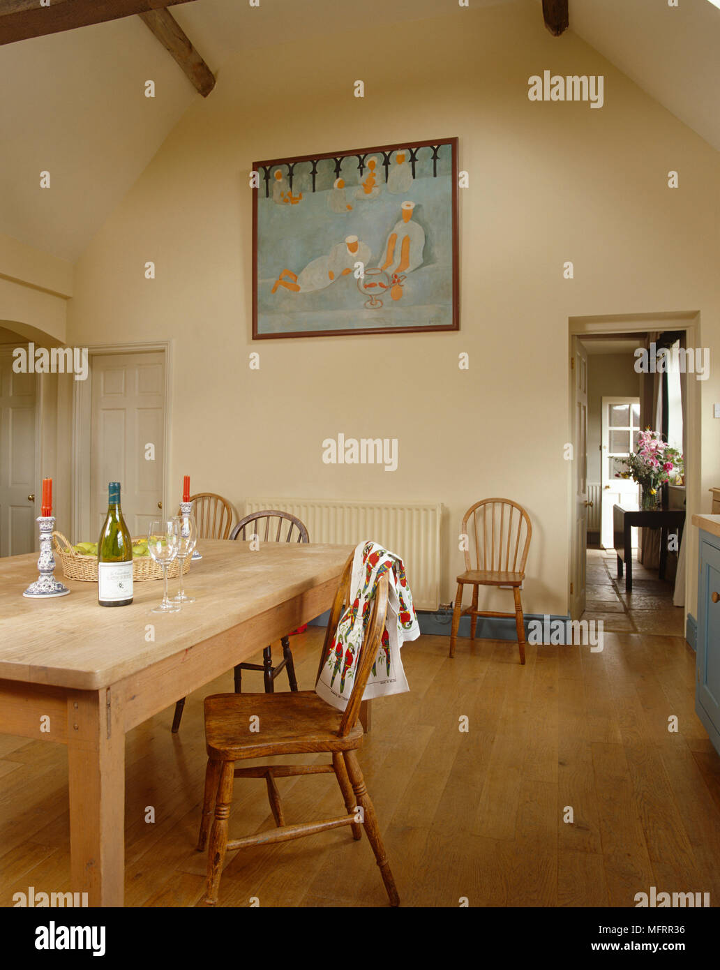 Simple Wooden Dining Table And Chairs In Country Style Kitchen Stock