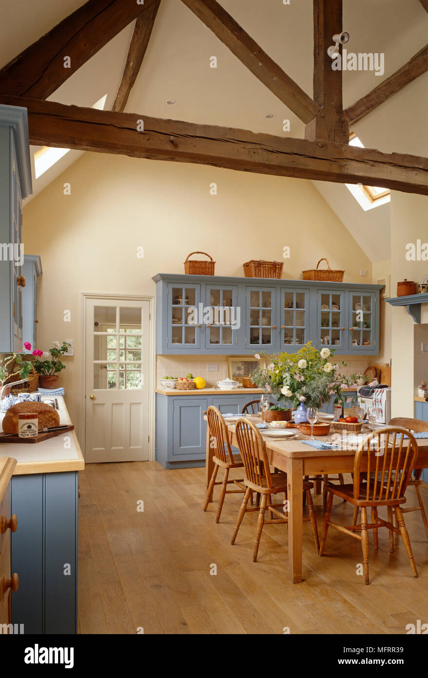 Wooden Dining Table And Chairs In Country Style Blue Kitchen