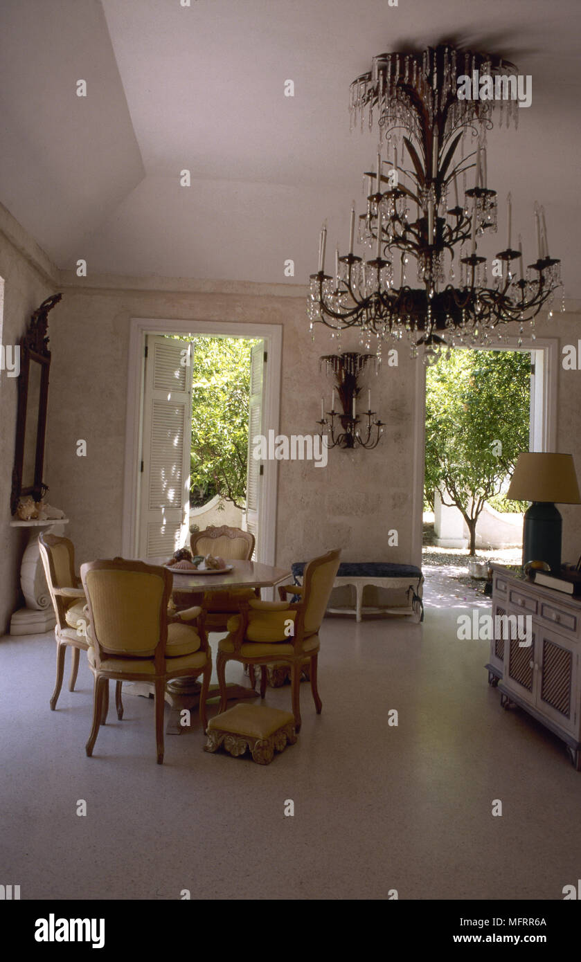 Traditional dining room with high ceilings stone walls marble floor round antique dining - Table cuisine bois ...
