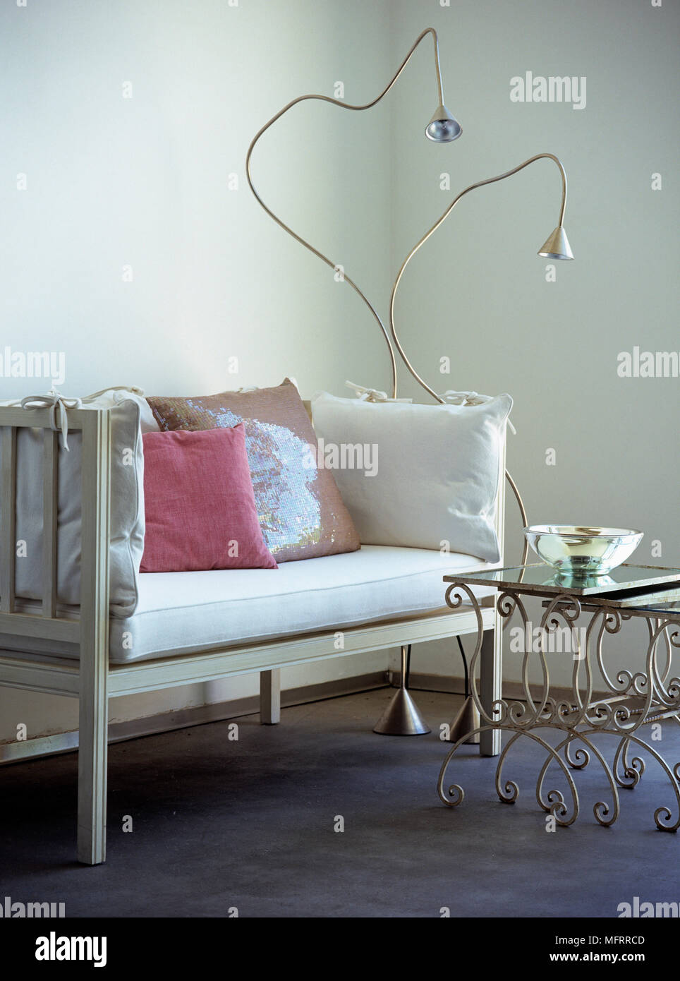 Modern Floor Lamps Next To White Wood Sofa In Corner Of Room