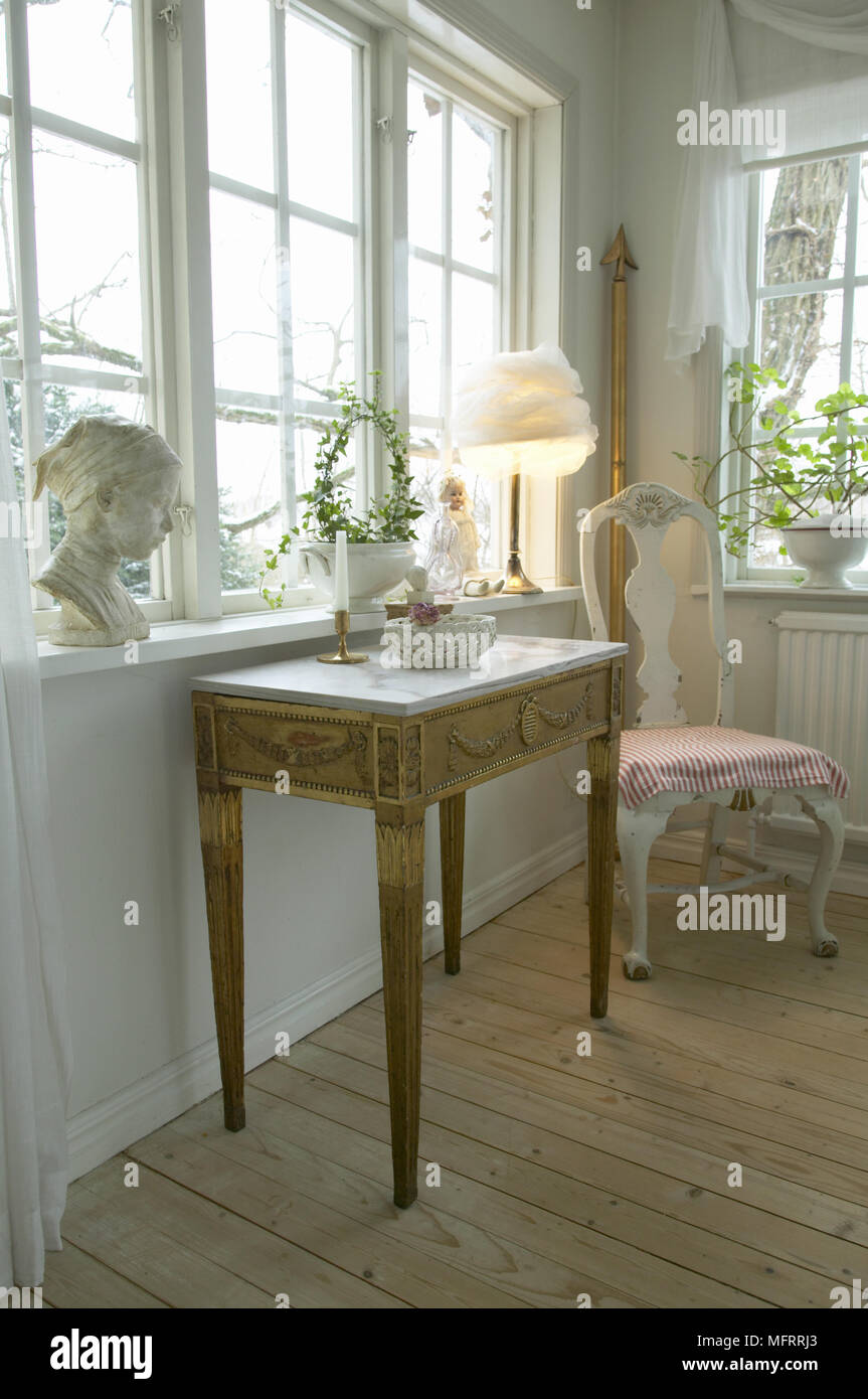 Swedish Sitting Room With White Painted Walls And Antique Furniture.