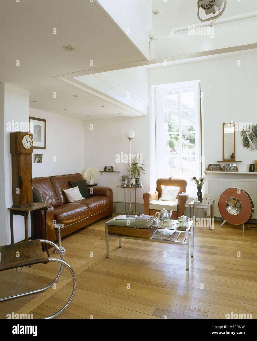 A Modern Sitting Room With Retro Styling Wood Floor Leather Sofa