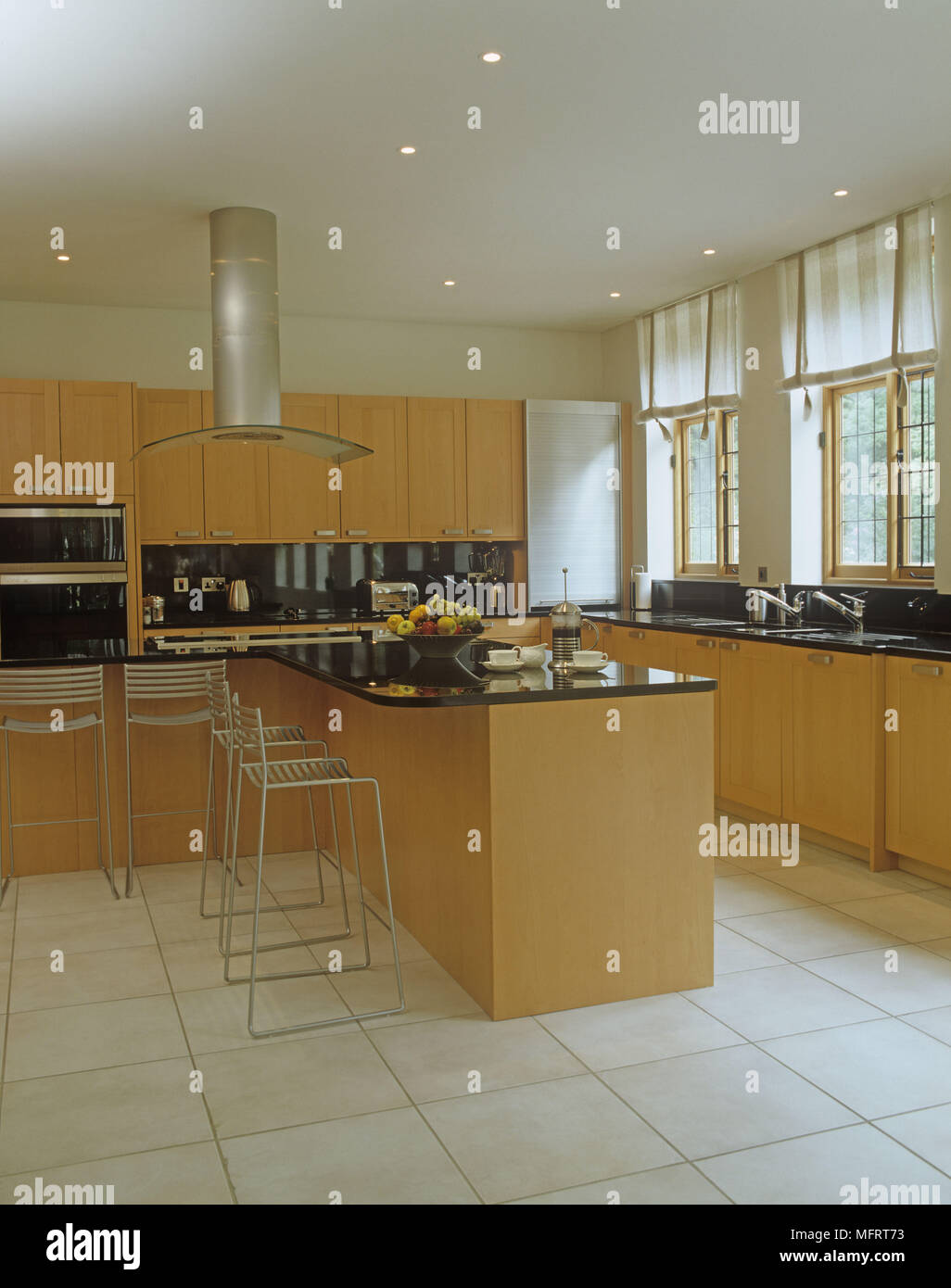 Kitchen island and stools in open plan area with worktop and integral appliances. & Kitchen island and stools in open plan area with worktop and ...