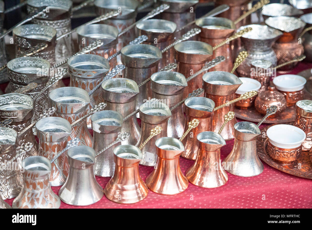 Rows of copper coffee pots on a souvenir stall in Sarajevo, Bosnia and Herzegovina - Stock Image