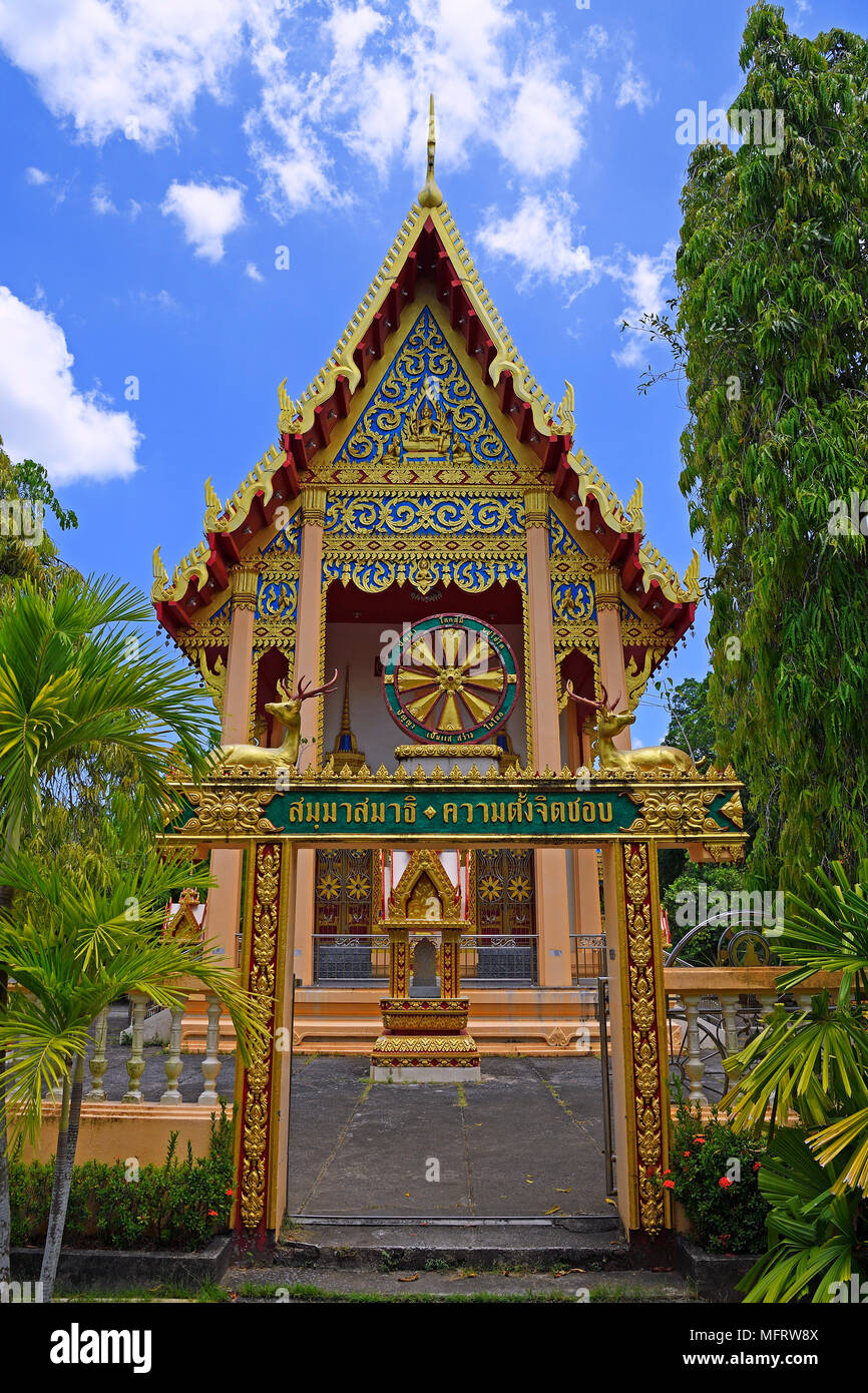 Building of the temple Wat Phra Thong with Wheel of Fortune, Phuket, Thailand - Stock Image