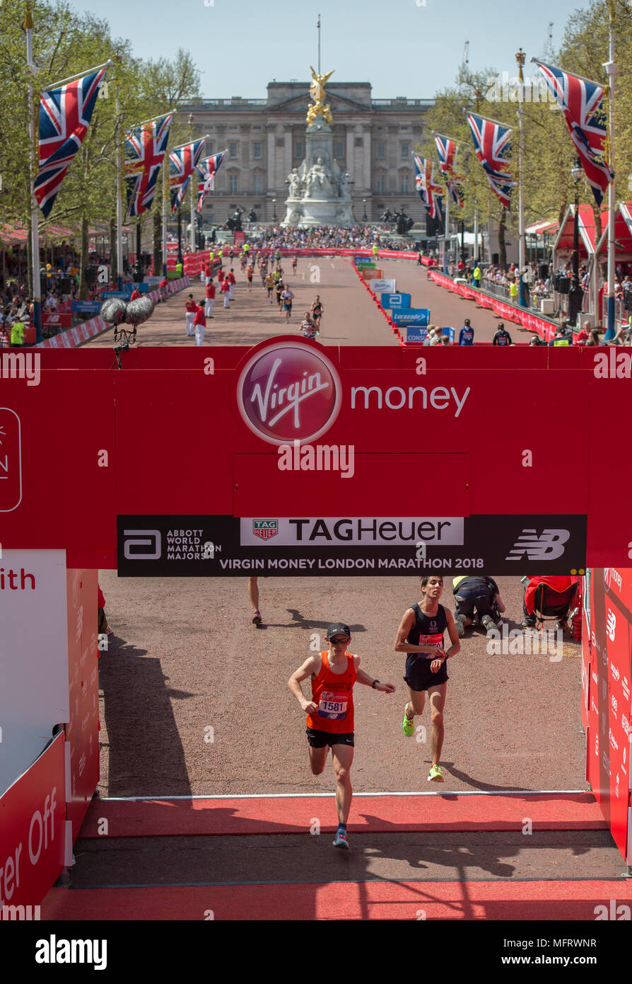 22 April 2018. Runners finishing the Mass Event at the Virgin Money London Marathon 2018 on The Mall. - Stock Image