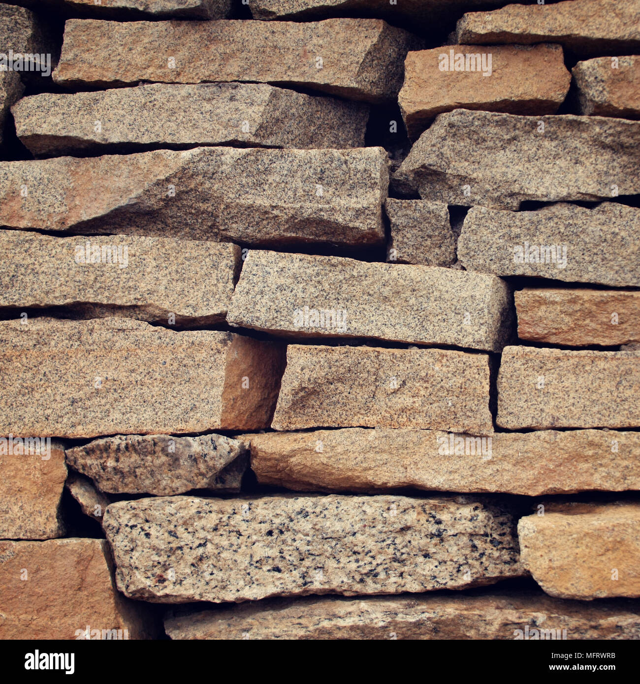 Pile of flat decorative stones. Close up. Grey colored stony texture. Building wall closeup. Abstract stony background. - Stock Image